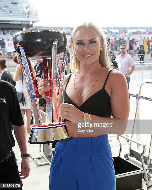 Olympic gold medalist Lindsey Vonn seen holding Lewis Hamilton's trophy attends the US Grand Prix Formula One World Championship at Circuit of the...