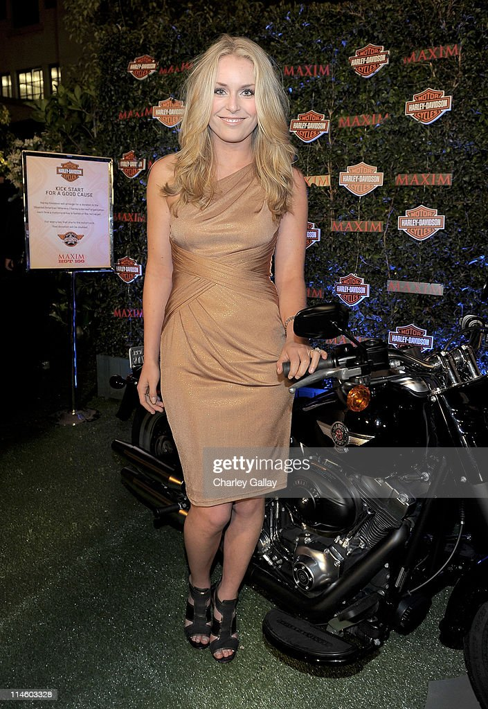 Olympic gold medalist Lindsey Vonn turns the key on a Harley-Davidson to raise money for Harley's Heroes at the 2010 Maxim Hot 100 Party held at Paramount Studios on May 19, 2010 in Los Angeles, California.