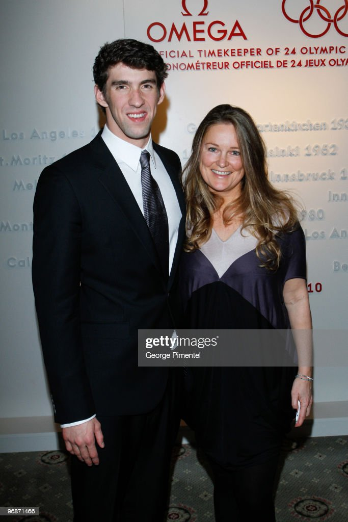 Olympic Gold Medalist Michael Phelps and Pamela Groberman attend the OMEGA Cocktail Celebration at the Fairmont Hotel on February 18, 2010 in Vancouver, Canada.