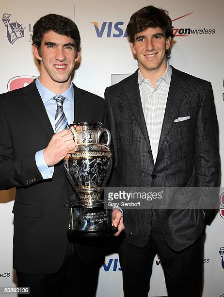 Olympic Gold Medalist Michael Phelps, and pro football player, Eli Manning, attend the 2008 Sports Illustrated Sportsman of the Year award...