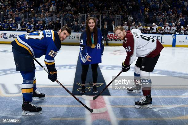 Olympic gold medalist Nicole Hensley drops the puck for Alex Pietrangelo of the St Louis Blues and Gabriel Landeskog of the Colorado Avalanche before...