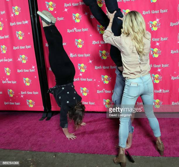 Olympic Gold medalist Shawn Johnson East husband football player Andrew East and actress Rebecca Zamolo attend social media influencer Annie...