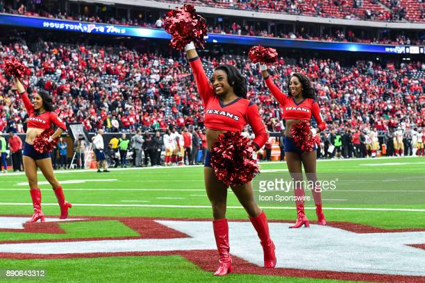 Olympic gold medalist Simone Biles performs with the Houston Texans cheerleaders during the football game between the San Francisco 49ers and the...