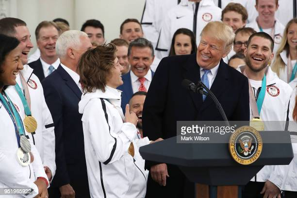Olympic gold medalist snowboarder Red Gerard reacts as US President Donald Trump speaks during a celebration of the USA 2018 Winter Olympic and...