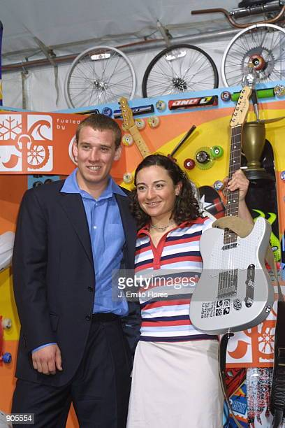 Olympic Gold Medalist snowboarder Ross Powers poses with Female Snowboarder of the Year winner Natasza Zurek during the 2002 ESPN Action Sports Music...