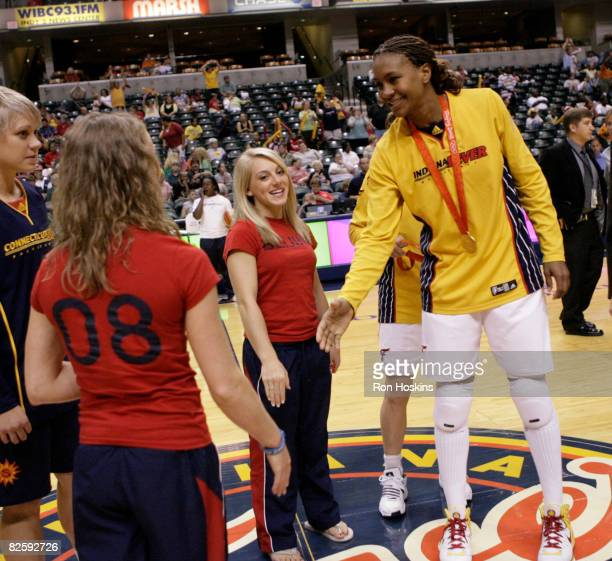 Olympic Gold Medalist Tamika Catchings of the Indiana Fever greets Olympic Gymasitcs Bridget Sloan and Samantha Peszek of which both won Silver...