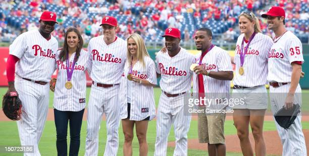 Olympic gold medalists Carli Lloyd Heather Mitts Jordan Burroughs and Susan Francia pose with Philadelphia Phillies Ryan Howard Chase Utley Jimmy...