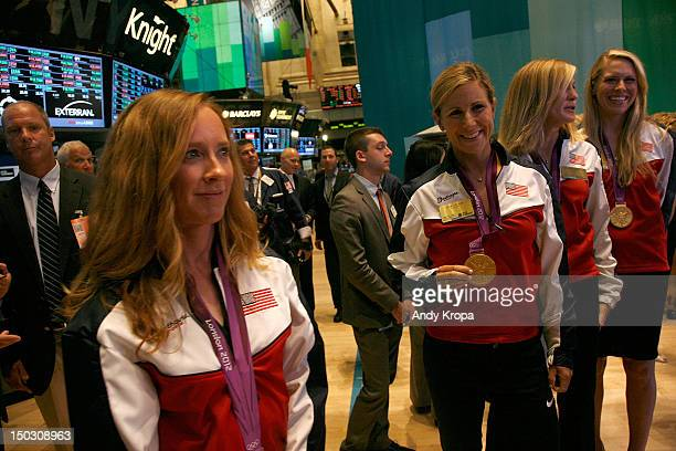 US Olympic gold medalists in Women's Rowing Mary Whipple Erin Cafaro Meghan Musnicki and Esther Lofgren ring the opening bell at the New York Stock...