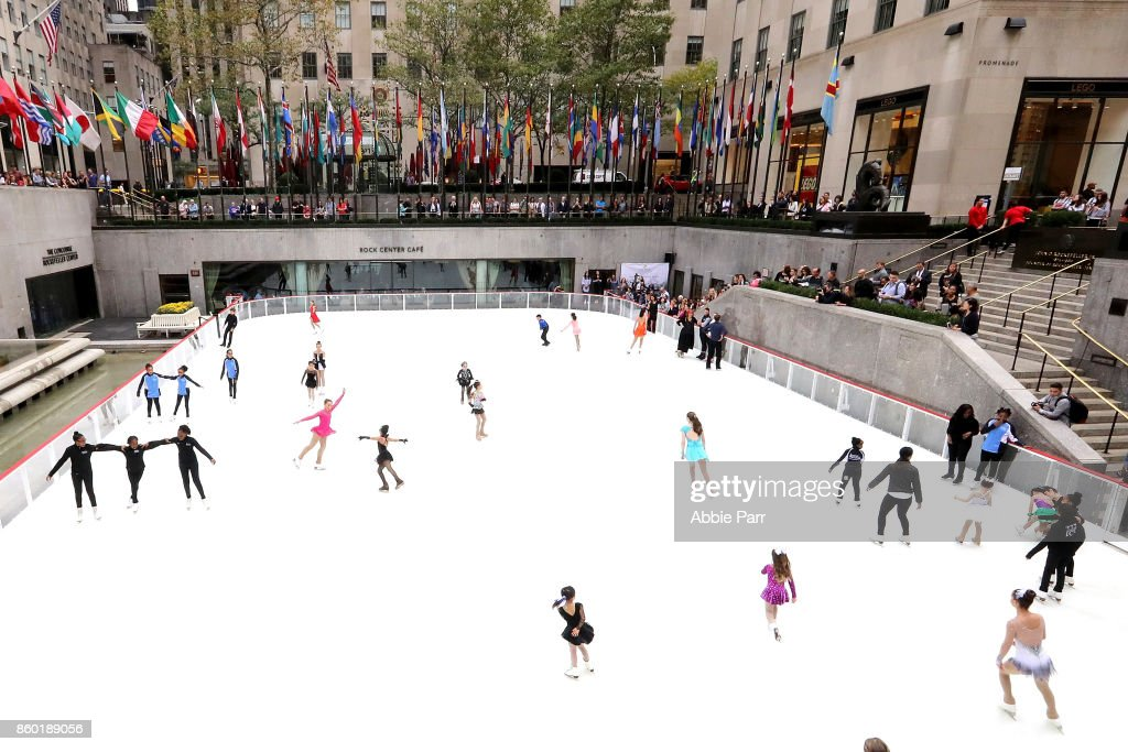 Olympic Gold Medalists Meryl Davis and Charlie White enjoy the season's first skate with other young individuals at The Rink at Rockefeller Center on October 11, 2017 in New York City.