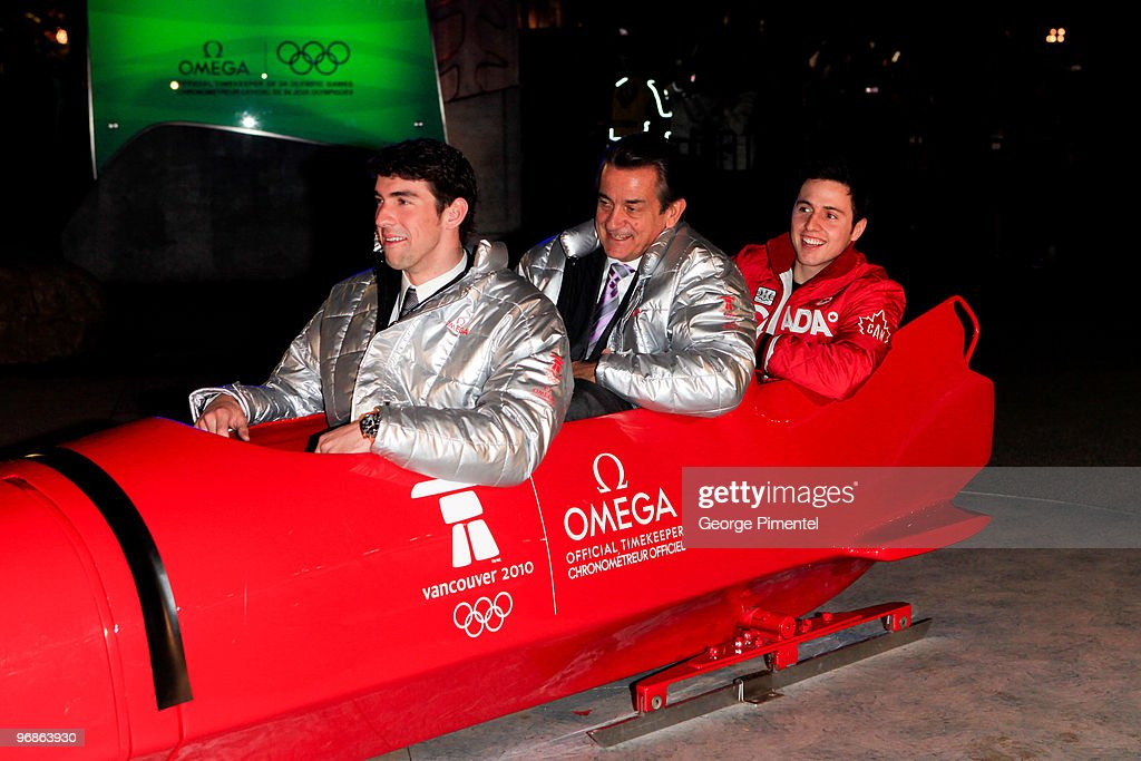 Olympic Gold Medalists Michael Phelps (L) and Alexandre Bilodeau (R) and President of OMEGA Stephen Urquhart (M) attend the OMEGA Cocktail Celebration at the Fairmont Hotel on February 18, 2010 in Vancouver, Canada.