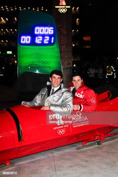 Olympic Gold Medalists Michael Phelps and Alexandre Bilodeau attend the OMEGA Cocktail Celebration at the Fairmont Hotel on February 18 2010 in...