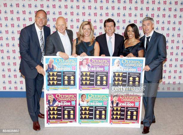 Olympic Gold Medalists Sir Steve Redgrave Duncan Goodhew Sally Gunnell Lord Sebastian Coe Dame Kelly Holmes and Jonathan Edwards holding a giant...