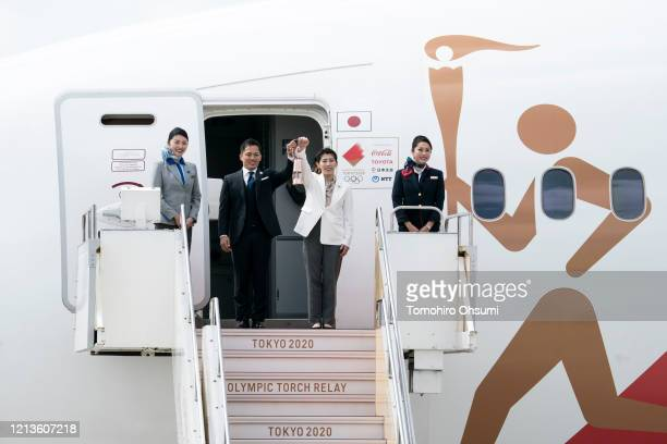 Olympic gold medalists Tadahiro Nomura and Saori Yoshida hold the Olympic flame during the Tokyo 2020 Olympic Games Flame Arrival Ceremony at the...