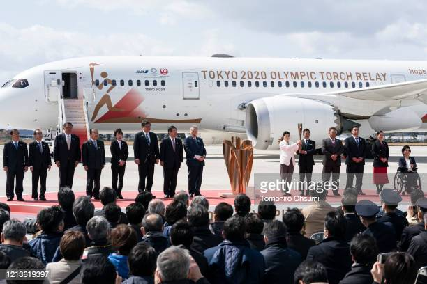 Olympic gold medalists Tadahiro Nomura and Saori Yoshida hold the Olympic torch as other representatives including Tokyo Olympic and Paralympic...