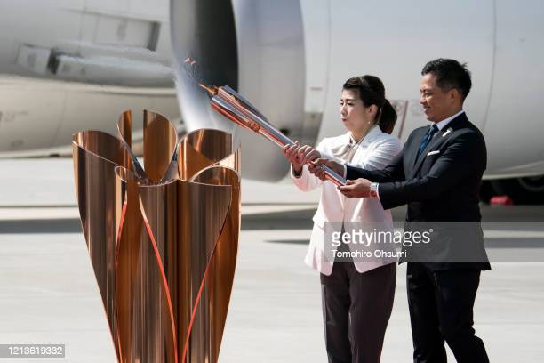 Olympic gold medalists Tadahiro Nomura and Saori Yoshida light the Olympic flame during the Tokyo 2020 Olympic Games Flame Arrival Ceremony at the...