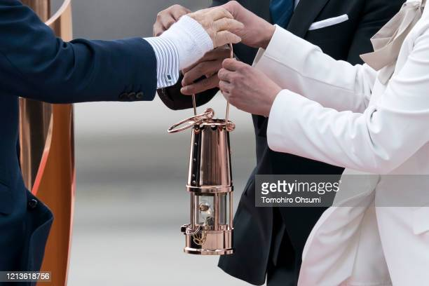 Olympic gold medalists Tadahiro Nomura and Saori Yoshida receive the Olympic flame from Tokyo Olympic and Paralympic Organizing Committee President...