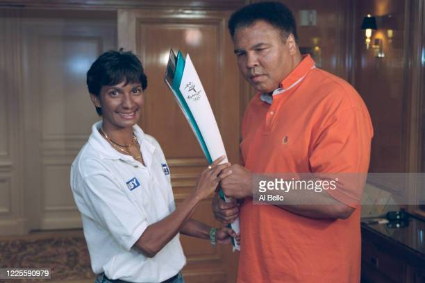 Olympic gold medallist and Heavyweight Boxing World Champion Muhammad Ali of the United States passes the Olympic Torch for the XXVII Summer Olympic...