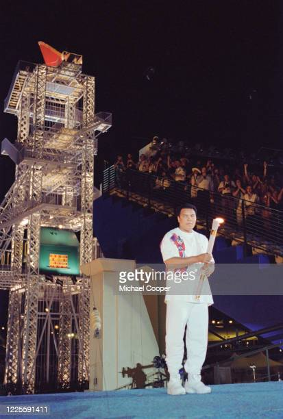 Olympic gold medallist and Heavyweight Boxing World Champion Muhammad Ali of the United States carries the Olympic Flame during the Opening Ceremony...