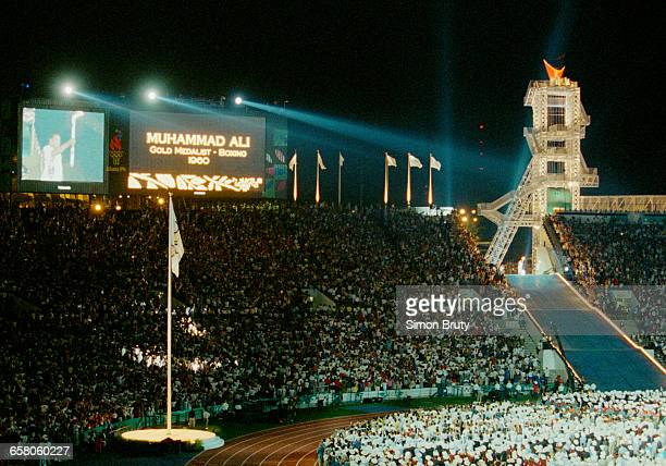 Olympic gold medallist and Heavyweight World Champion Muhammad Ali of the United States lights the Olympic Flame during the Opening Ceremony of the...