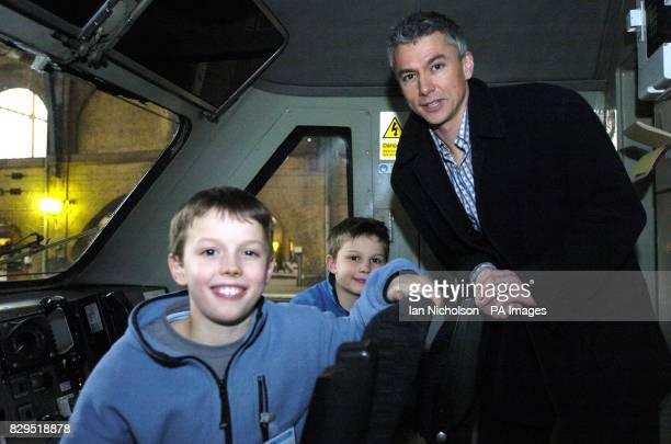 Olympic gold medallist and triple jump world record holder Jonathan Edwards is joined in the cab by his sons Nathan aged nine and Sam left after...