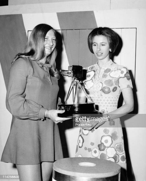 Olympic gold medallist Mary Peters, British track athlete, receives the BBC sports Personality of the Year award from Princess Anne, the previous...