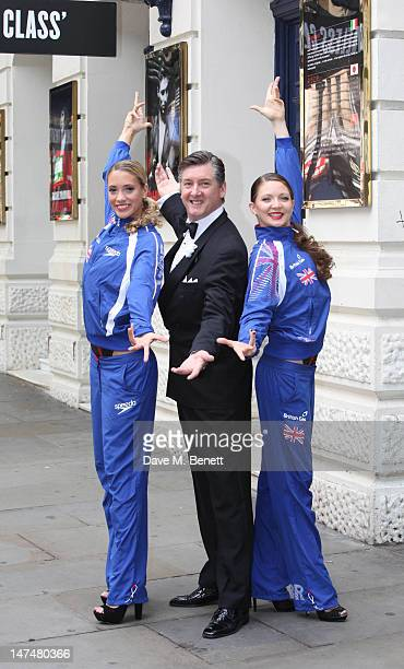 Olympic Gold Medallist Robin Cousins poses with Jenna Randall and Olivia Federici of Team GB's Synchronised Swimming team at the Garrick Theatre on...