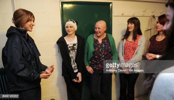 Olympic gold medalwinning cyclist Joanna Roswell meets members of the Lottery funded project Alopecia UK during a visit to Croydon Arena London
