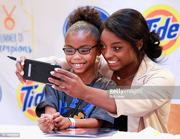 Olympic gold medalwinning gymnast Simone Biles meets with fans in her home town at Kroger on September 30 2016 in Houston Texas