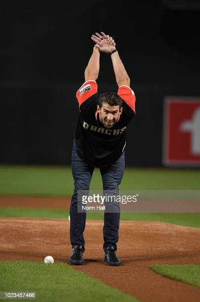 Olympic gold metalist swimmer Michael Phelps gets ready to throw out the ceremonial first pitch prior to a game between the Arizona Diamondbacks and...