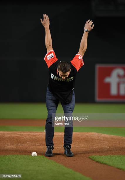 Olympic gold metalist swimmer Michael Phelps prepares to throw out the ceremonial first pitch prior to a game between the Arizona Diamondbacks and...