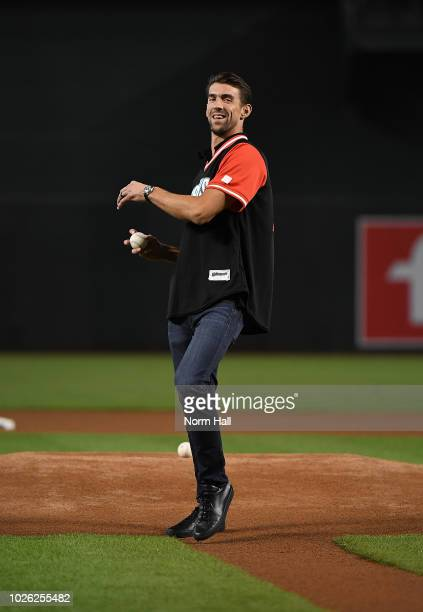 Olympic gold metalist swimmer Michael Phelps throws out the ceremonial first pitch prior to a game between the Arizona Diamondbacks and the Seattle...