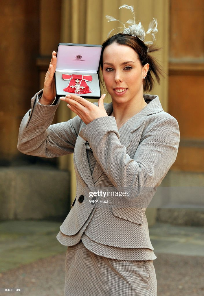 Olympic gymnast Beth Tweddle, from Liverpool, poses with her MBE after being presented with it by Prince Charles, Prince of Wales for services to gymnastics at Buckingham Palace on May 21, 2010 in London, England.