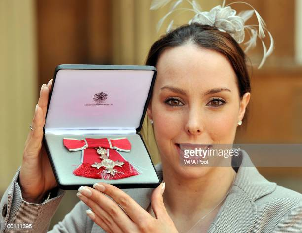 Olympic gymnast Beth Tweddle from Liverpool poses with her MBE after being presented with it by Prince Charles Prince of Wales for services to...