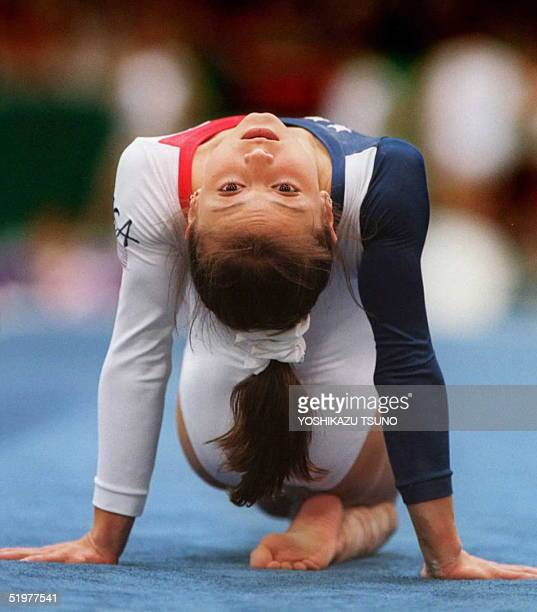 Olympic gymnast Dominique Moceanu practices floor exercises during a training session 16 July at the Georgia Dome in Atlanta three days before the...