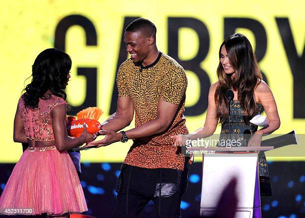 Olympic gymnast Gabby Douglas accepts Best Female Athlete from NBA player Russell Westbrook and actress Megan Fox onstage during Nickelodeon Kids'...