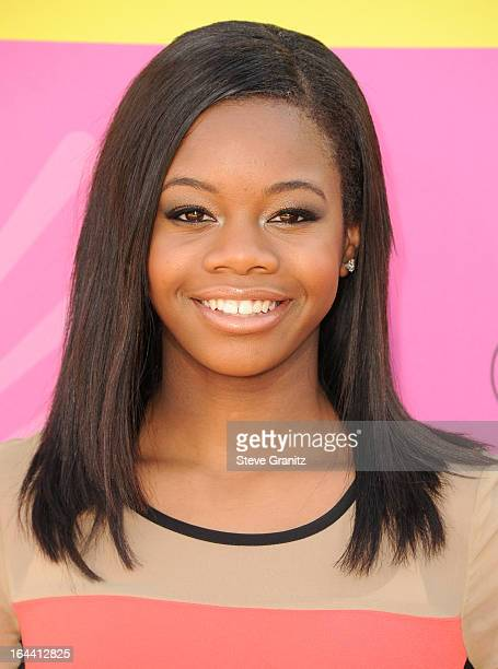 Olympic gymnast Gabby Douglas arrives at Nickelodeon's 26th Annual Kids' Choice Awards at USC Galen Center on March 23 2013 in Los Angeles California