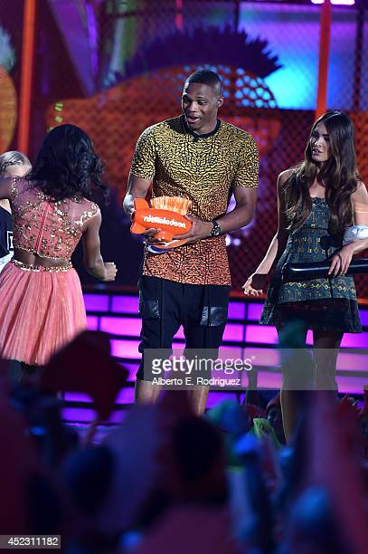 Olympic gymnast Gabby Douglas NBA player Russell Westbrook and actress Megan Fox speak onstage during Nickelodeon Kids' Choice Sports Awards 2014 at...