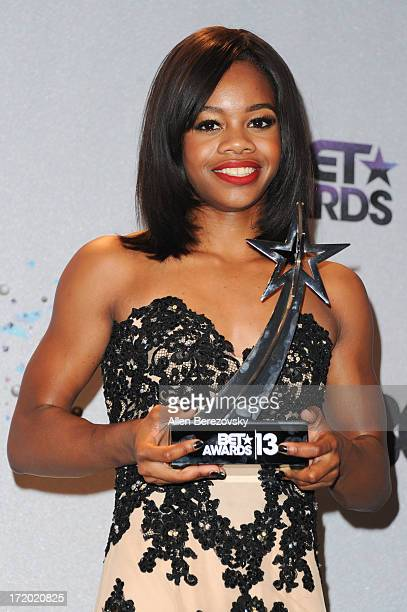 Olympic gymnast Gabby Douglas poses in the press room of the 2013 BET Awards at Nokia Plaza LA LIVE on June 30 2013 in Los Angeles California