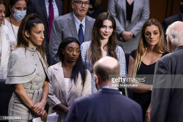 Olympic Gymnasts Aly Raisman, Simone Biles, McKayla Maroney and NCAA and world champion gymnast Maggie Nichols are approached by Sen. Pat Leahy after...