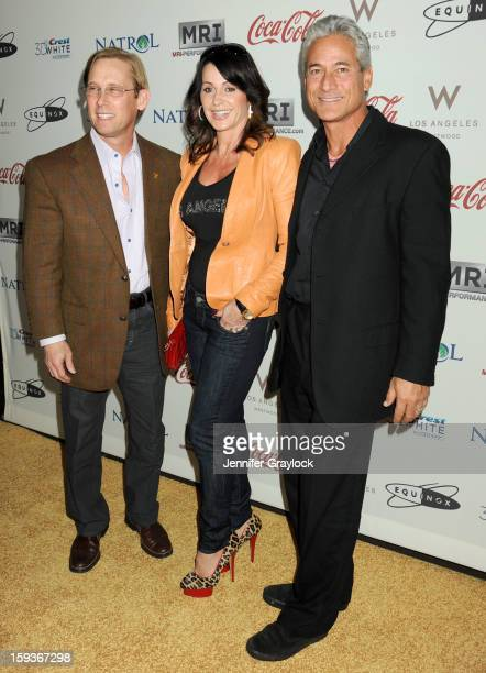 Olympic gymnasts Bart Conner and Nadia Comaneci and Olympic diver Greg Louganis attend the Gold Meets Gold Event, held at the Equinox Sports Club...