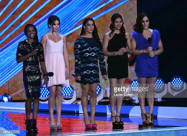 US Olympic gymnasts Gabby Douglas McKayla Maroney Alexandra Raisman Kyla Ross and Jordyn Wieber speak onstage during the 2012 MTV Video Music Awards...