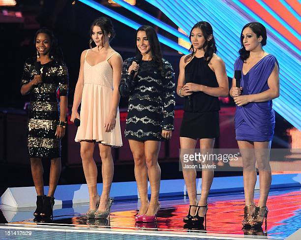 US Olympic gymnasts Gabby Douglas McKayla Maroney Alexandra Raisman Kyla Ross and Jordyn Wieber speak onstage at the 2012 MTV Video Music Awards at...