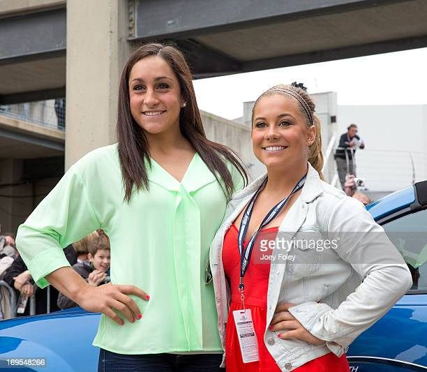 Olympic gymnasts Jordyn Wieber and Shawn Johnson attends the 2013 Indianapolis 500 at Indianapolis Motorspeedway on May 26 2013 in Indianapolis...