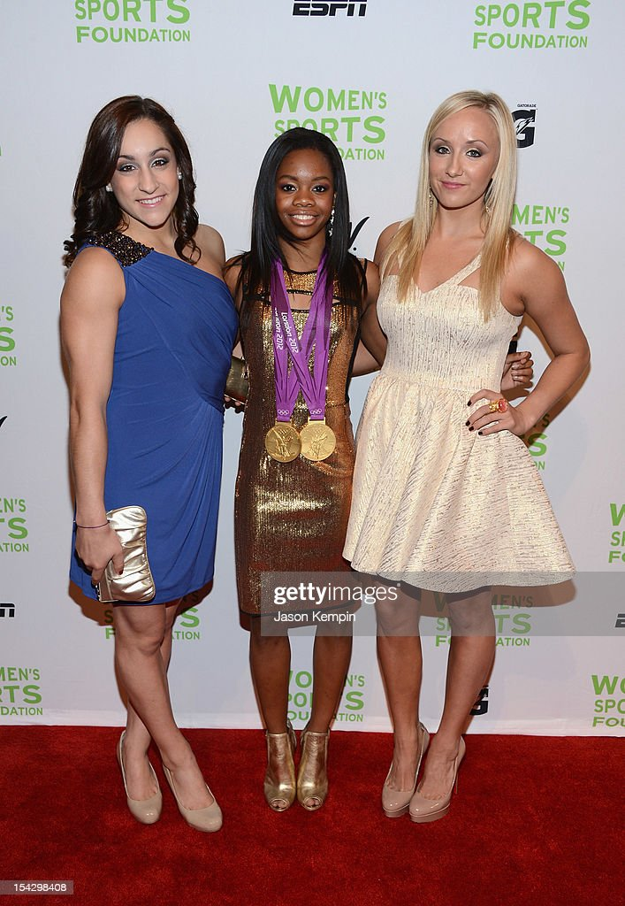 Olympic gymnasts Jordyn Wieber, Gabrielle Douglas, and Anastasia 'Nastia' Liukin attend the 33rd Annual Salute To Women In Sports Gala at Cipriani Wall Street on October 17, 2012 in New York City.