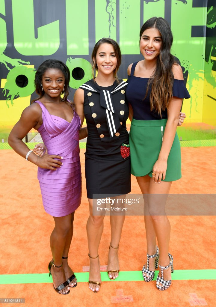 Olympic gymnasts Simone Biles and Aly Raisman and actor Daniella Monet attend Nickelodeon Kids' Choice Sports Awards 2017 at Pauley Pavilion on July 13, 2017 in Los Angeles, California.