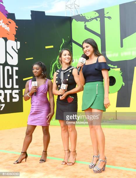 Olympic gymnasts Simone Biles and Aly Raisman and actor Daniella Monet attend Nickelodeon Kids' Choice Sports Awards 2017 at Pauley Pavilion on July...