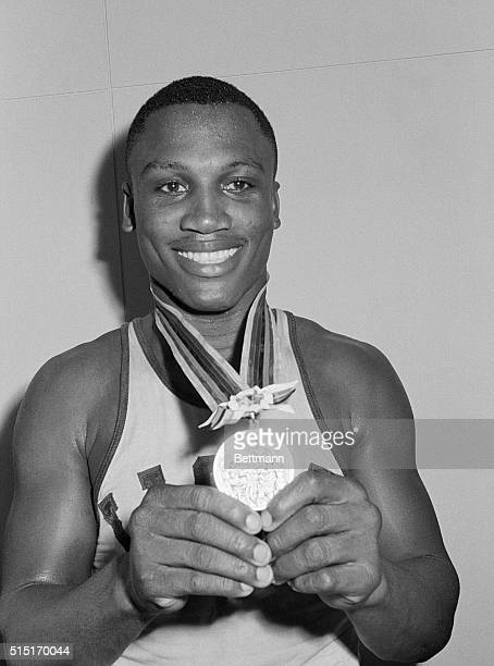US Olympic heavyweight boxer Joe Frazier holds the gold medal he won after defeating Hans Huber of Germany in the Olympic Boxing Finals