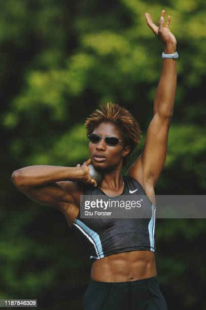 Olympic Heptathlon champion Denise Lewis of Great Britain training with the shot put on 2nd July 2002 at Battersea Park London England
