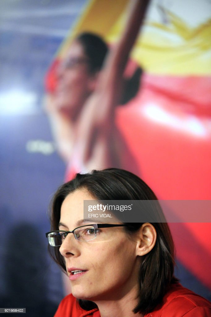 Olympic high jump champion Belgian Tia Hellebaut gives a press conference to announce her retirement from the sport on December 5, 2008 in Brussels. The former heptathlete who turned exclusively to the high jump because of a shoulder injury said she and her partner Wim Vandeven, who is also her coach, came to the decision because they are expecting a baby. The 30-year-old is three months pregnant.