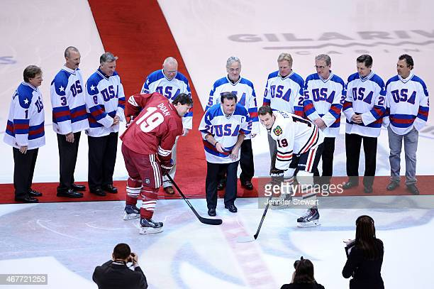 Olympic hockey team player Mike Eruzione drops the puck inbetween Shane Doan of the Phoenix Coyotes and Jonathan Toews of the Chicago Blackhawks...